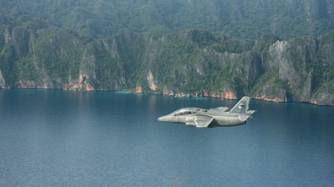 An AS-211 flying over the mountains and the sea. Photo courtesy of Philippine Fly Boy thru flickr