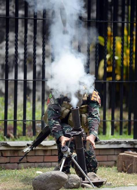 A soldier firing the M224 Mortar. Photo courtesy of the Philippine Star