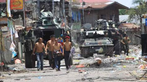 A Scorpion Light Tank in the background behind some capture MNLF scum. Photo courtesy of