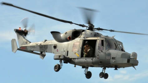 An AW159 in flight. Photo courtesy of Cpl Kellie Williams, RLC/MOD thru Wikipedia Commons.