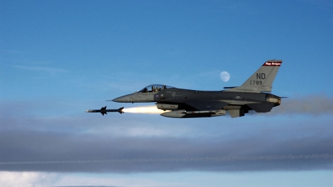 "Lockheed Martin's ""precious little"" F-16 firing an AIM-7 Sparrow missile. Photo courtesy of Wikipedia Commons."