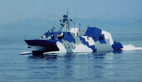 China's latest Stealth Missile Boat, the garishly painted Houbei-class. Makes you wonder what kind of a navy paints their ship like a pimp. Photo courtesy of the Club Military News Website