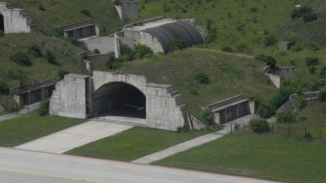 An example of a Hardened Aircraft Shelter in the Czech Republic. Photo courtesy of flightlog thru Wikipedia Commons.