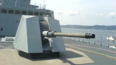 An Oto Melara 76/62 Super Rapid (SR) Gun with the new Stealth Cupola, photo courtesy of Ketil thru Wikipedia Commons