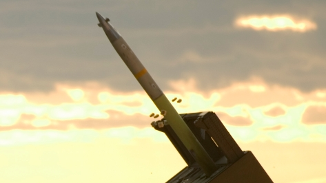 A Guided Multiple Launch Rocket System (GMLRS) in action. Photo courtesy of Wikimedia Commons.